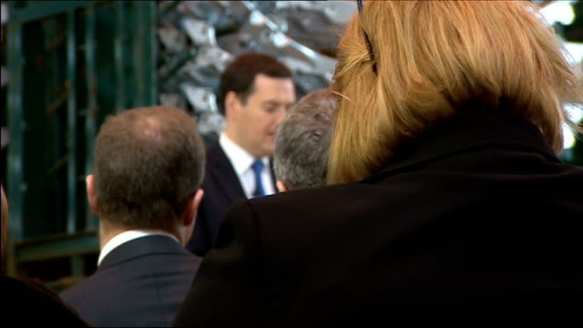 george osborne visit to sertec factory and speech cutaways; audience waiting for osborne to arrive to deliver speech / osborne and adams arrival for... - cut video transition stock videos & royalty-free footage