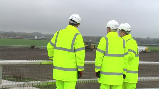 george osborne visits a1 road; england: yorkshire: catterick ext chancellor george osborne mp along with engineeers in high-visability jacket and... - engineering stock videos & royalty-free footage