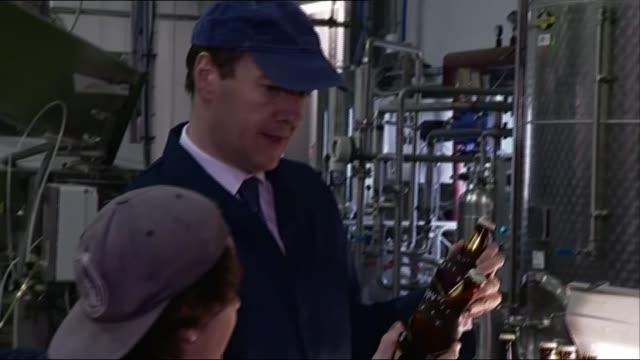 George Osborne visits Sheppy's Cider in Taunton ENGLAND Somerset Taunton Sheppy's Cider PHOTOGRAPHY** George Osborne MP putting bottles of cider on...