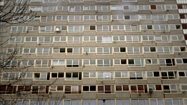 george osborne's 2013 budget london high rise housing block gv run down housing block and concrete walkways soft focus shot of mother and child... - soft focus stock videos & royalty-free footage