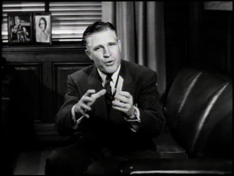 WS George Romney President of American Motors seated talking to camera Romney says that AMC cars are quality products with a lot of exclusive...