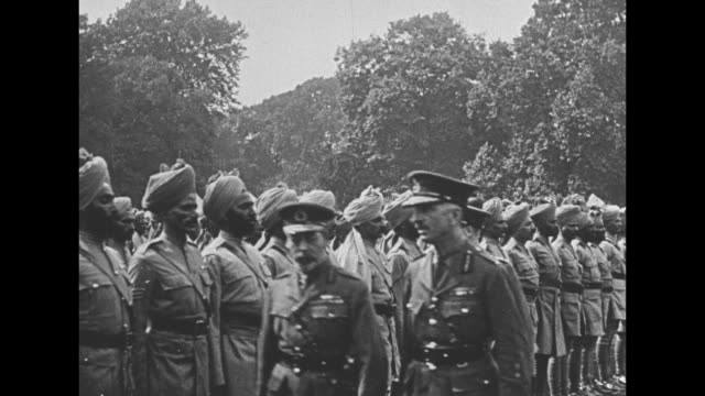 george v reviews indian troops all wearing turbans men carry their regimental standards past the reviewing stand / men marching from the admiralty... - colonial stock videos & royalty-free footage