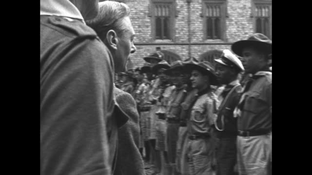 george vi queen mother elizabeth and princess margaret are accompanied by thomas corbett chief scout as they meet with boy scouts from the british... - princess margaret 1950 stock videos and b-roll footage