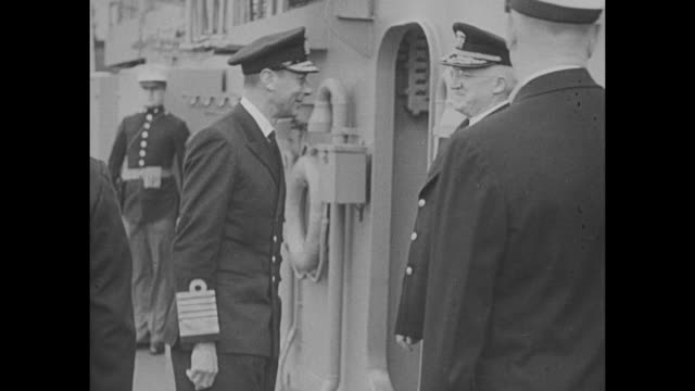 vs george vi walks between two flanking lines of us sailors / he greets commander of us naval forces in europe admiral harold r stark / george... - quality control stock videos & royalty-free footage