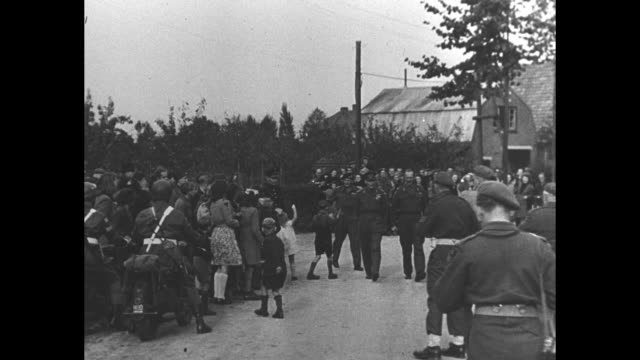 vídeos de stock, filmes e b-roll de ls george vi's parked car as soldiers and civilians stand nearby / king walks past and salutes waving crowd / ms of crowd then pan down to feet clad... - bernard l. montgomery