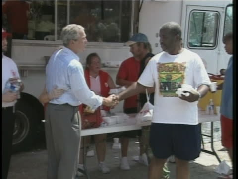 george w. bush greets victims and salvation army relief workers in biloxi, mississippi in the aftermath of hurricane katrina. - salvation army stock videos & royalty-free footage