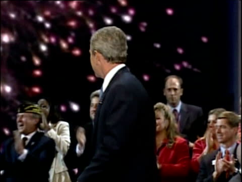 george w bush kisses his wife laura then they wave to crowds at republican convention new york; 03 sep 04 - 2000s style stock videos & royalty-free footage