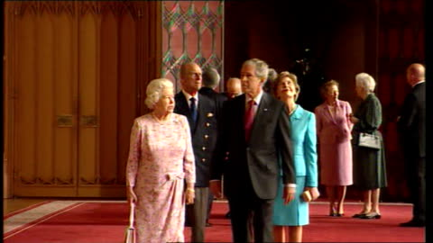 george w bush uk visit: day 1; berkshire: windsor castle: st george's hall: int bush along next queen elizabeth ii followed by laura next prince... - day 1 stock videos & royalty-free footage