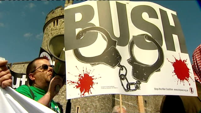 george w bush uk visit: day 1; stop the war protesters demonstrating with placards outside walls of windsor castle, two mounted police along past vox... - day 1 stock videos & royalty-free footage