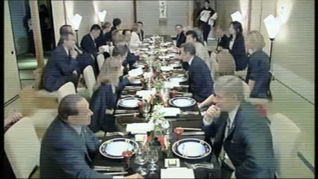 int george w bush winking at kiyoko fukuda and gordon brown mp seated alongside laureen harper various of g8 leaders and partners seated around... - 座る点の映像素材/bロール