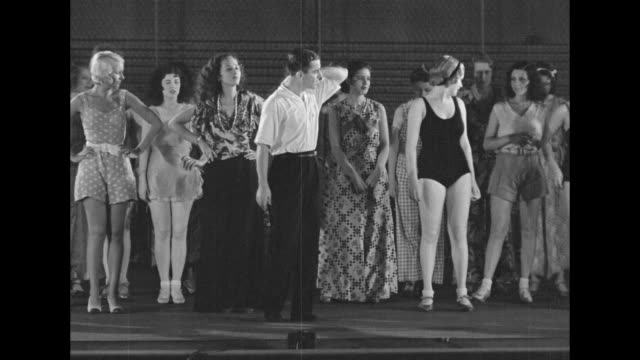 george white writer producer and director of show scandals walks onto stage past chorus girls sitting and waiting he commands them to stand up and... - broadway show stock videos and b-roll footage