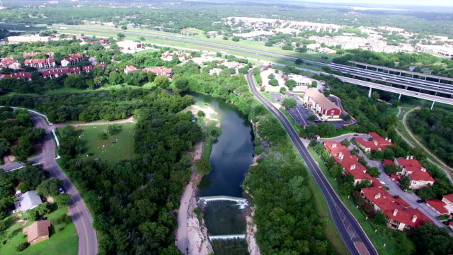 georgetown texas aerial fly by over san gabriel river apartments hill country town - georgetown texas stock videos & royalty-free footage