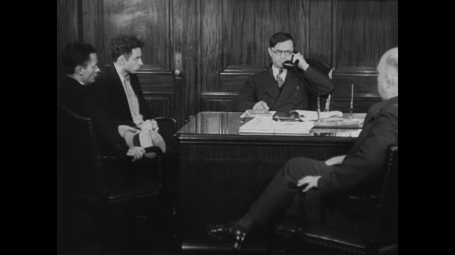 stockvideo's en b-roll-footage met georgia governor eugene talmadge sitting in chair looking serious governor eugene talmadge talking w/ men about strike calling military officer... - 1946