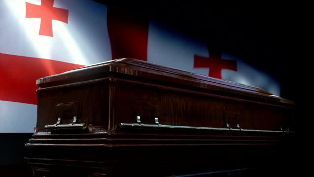棺の後ろのグルジアの旗 - ジョージア調点の映像素材/bロール