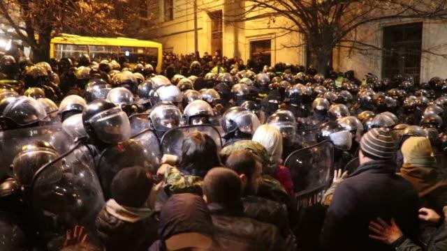 vídeos y material grabado en eventos de stock de georgian opposition supporters take part in a protest rally in front of the parliament building in tbilisi, georgia on november 26, 2019. protesters,... - georgia