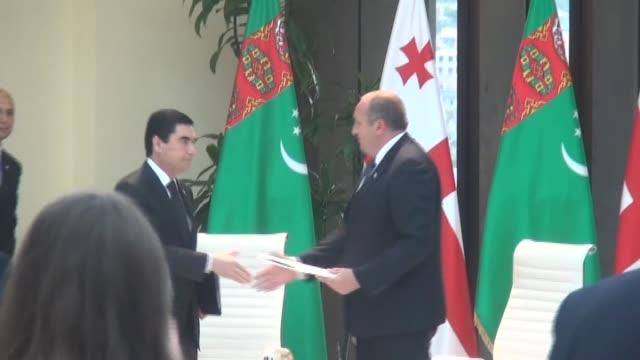 Georgian President Giorgi Margvelashvili welcomes his Turkmen counterpart Gurbanguly Berdimuhamedow at presidency building in Tbilisi Georgia on July...