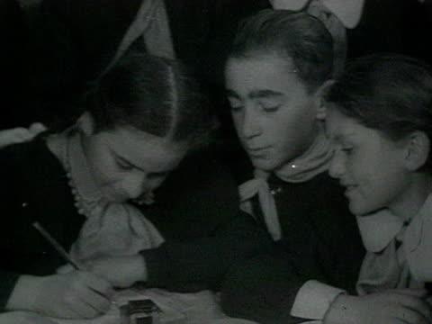 vídeos y material grabado en eventos de stock de georgian pupils around table writing congratulation letter to stalin audio / gori, georgia - georgia