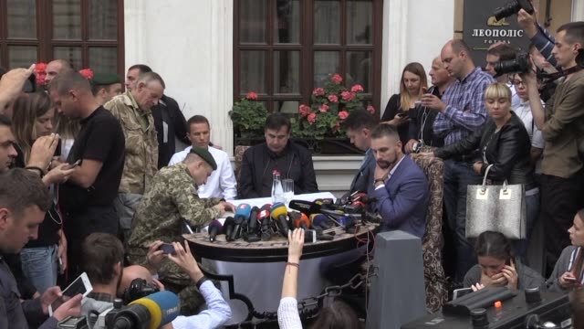 georgia's former president mikheil saakashvili reacts after ukrainian border guard officers notify him that he committed an administrative offence... - ukraine stock videos & royalty-free footage