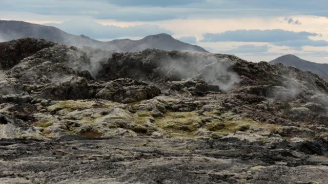 Geothermal area in the Krafla Volcanic Region Iceland, Smoking  fields of volcanic lava.