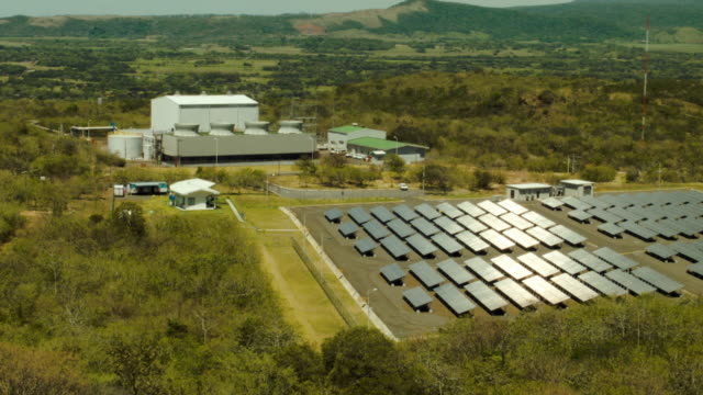 geothermal power plant is seen next to a solar power park run by the costa rican electricity institute. - san jose costa rica stock videos & royalty-free footage