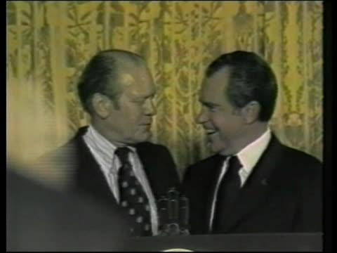 Gerald Ford suffers stroke LIB MAT HELD WASHINGTON MS Gerald Ford along to podium MS Ford standing on podium with former US President Richard Nixon...