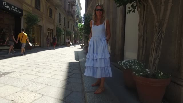 Geraldine Alasio wearing a HM dress K Jaques shoes Céline bag Rayban sunglasses and Hermes watch is seen during Milan Men's Fashion Week...