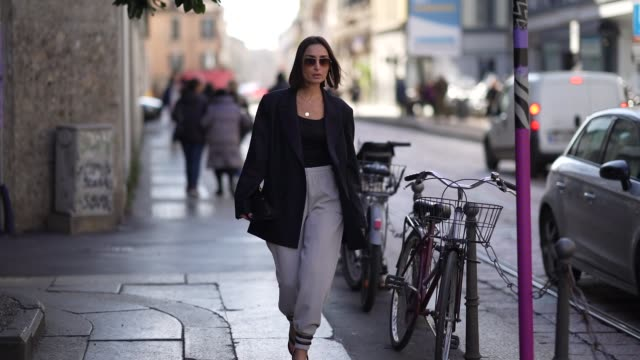 geraldine boublil wears sunglasses, a navy blue oversized blazer jacket, a black top, a necklace, gray pants, black shoes, outside koche x pucci,... - gray jacket stock videos & royalty-free footage