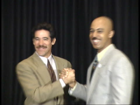geraldo rivera and montel williams shaking hands posing for paparazzi on red carpet - friars roast 1993 stock videos and b-roll footage