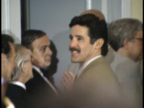 geraldo rivera standing in crowd looking around before ceremony - friars roast 1993 stock videos and b-roll footage