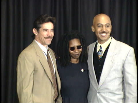 geraldo rivera whoopi goldberg and montel williams pose for paparazzi on red carpet - friars roast 1993 stock videos and b-roll footage