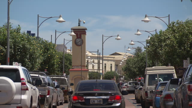 geraldton low angle shot town centre 'freemasons hotel' and main street including clock tower with traffic - main tower stock-videos und b-roll-filmmaterial