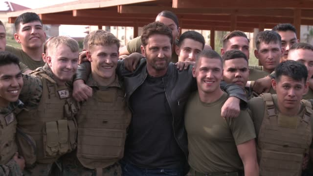 Gerard Butler and troops at 'London Has Fallen' Military Premiere At Camp Pendleton at Camp Pendleton on February 26 2016 in Oceanside California