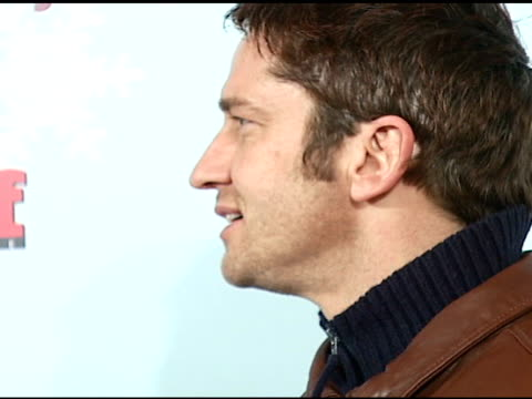 Gerard Butler at the Stuff Magazine 'Toys for Bigger Boys' Charity Party at the Hammerstein Ballroom in New York New York on December 5 2006