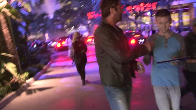 Gerard Butler greets fans while departing the first game of the Laker Season at Staples Center in Los Angeles in Celebrity Sightings in Los Angeles