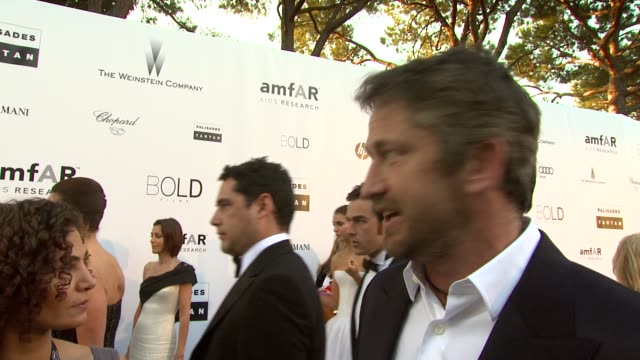 Gerard Butler jokes about bidding at the amfAR Cinema Against AIDS Gala at Antibes