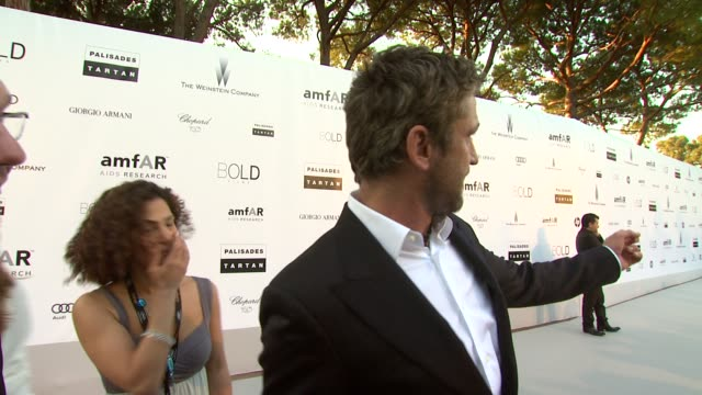 Gerard Butler jokes about location looking like his house at the amfAR Cinema Against AIDS Gala at Antibes