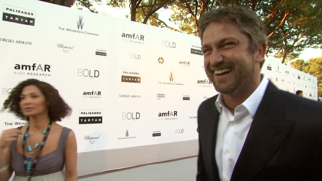 Gerard Butler joking about the Hotel du Cap being his house at the amfAR Cinema Against AIDS Gala at Antibes