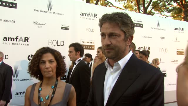 Gerard Butler on how he hopes that everyone will bid on something tonight at the amfAR Cinema Against AIDS Gala at Antibes