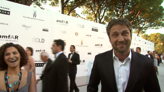 Gerard Butler on Mira Husseini being a family friend and his mother's favourite person in the world at the amfAR Cinema Against AIDS Gala at Antibes