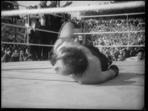 gerhard hecht writhing around in pain on floor of boxing ring / berlin / newsreel - 1951 stock videos & royalty-free footage