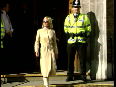 Hertfordshire Watford Geri Halliwell out of court down steps along Halliwell standing by door to car