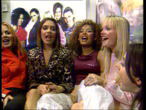 vídeos de stock e filmes b-roll de geri halliwell makes the record books lib london spice girls sitting in studio singing during interview - spice girls