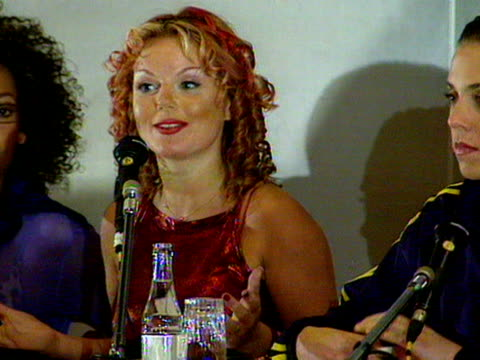 vídeos de stock e filmes b-roll de geri halliwell tells journalists at the cannes film festival what they can expect from the new spice girls movie - spice girls