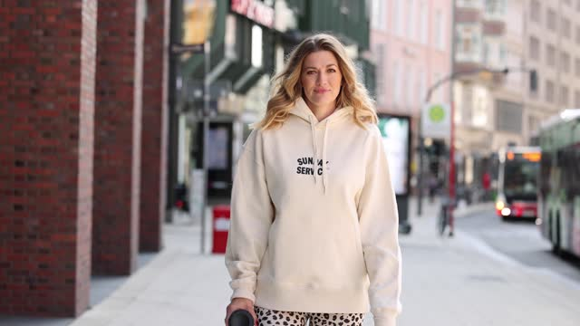 german actress nina bott wears grey and light blue sneakers by nike, a black to-go reusable cup by hey soho, cream leggings with dark brown leopard... - leggings stock videos & royalty-free footage