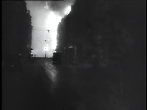 german aircraft attack london with bombs causing fires. - bomber stock videos & royalty-free footage