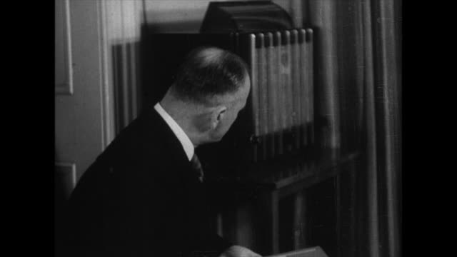 german ambassador to japan eugen ott listens to a radio speech by fuhrer adolf hitler and promises support for the italian embassy - kamikawa subprefecture stock videos and b-roll footage