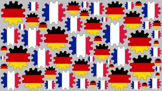 vidéos et rushes de engrenages de drapeau allemand et français tourne à fond - allemagne