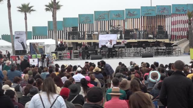 german and mexican artists staged a show on the border with the united states in protest at washington's plans to build a wall thrilling hundreds but... - baja california norte stock videos & royalty-free footage