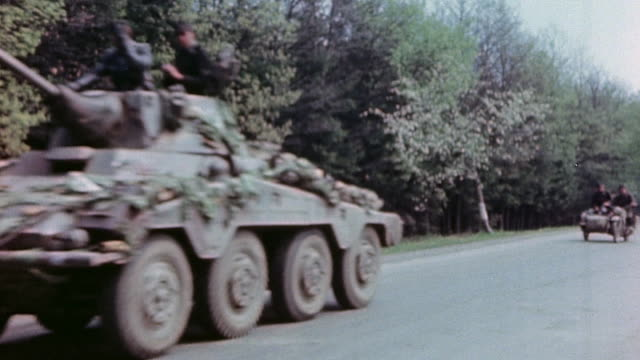 vidéos et rushes de pan german army armored column including sdkfz 234 armored car moving along road - wehrmacht