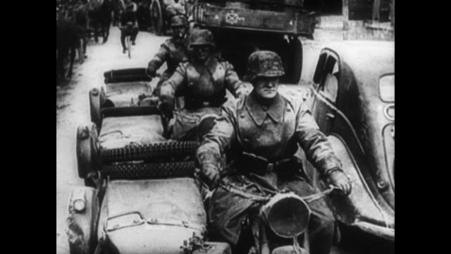 / german army marching along roads, carrying guns / soldiers driving side cars past walking troops / tanks along road. the german army during wwii on... - sidecar stock videos & royalty-free footage